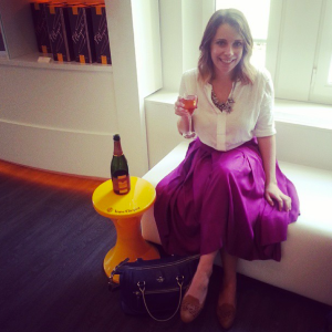 Anika at Veuve Cliquot in her fabulous midi skirt